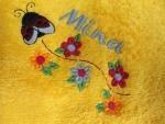 Klettlatz Muttergotteskäfer mit Blumen